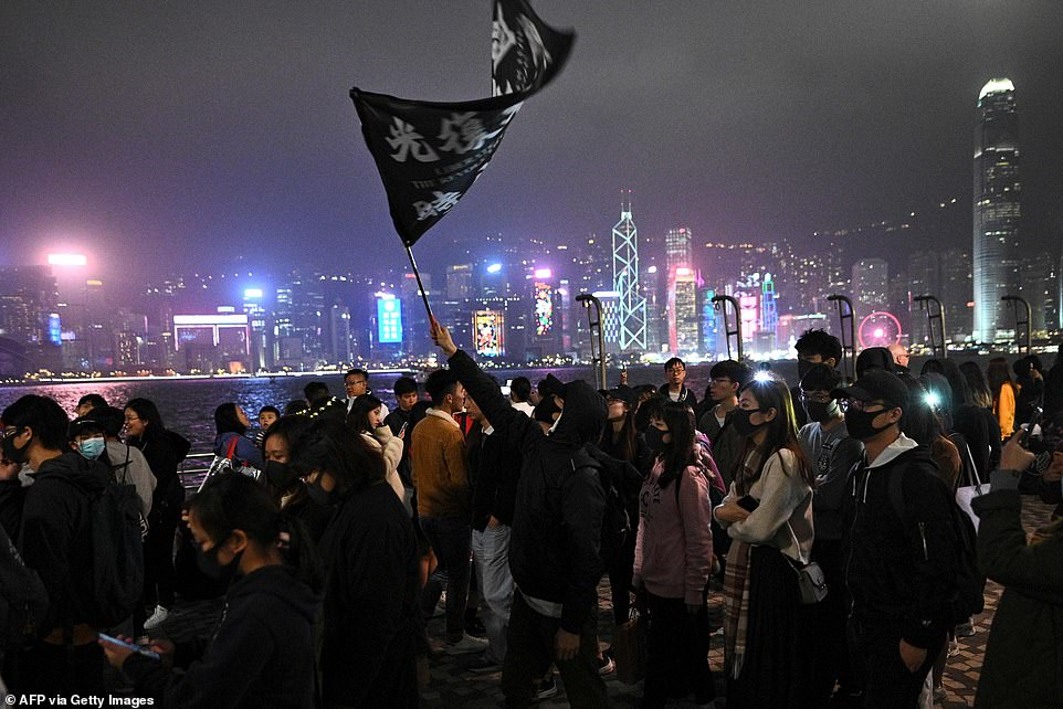 Pro-democracy protesters take part in a march along the promenade of Tsim Sha Tsui district in Hong Kong to mark New Year