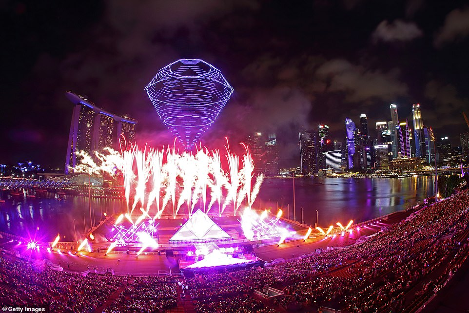 A light show erupts as Singaporeans celebrate the New Year tonight