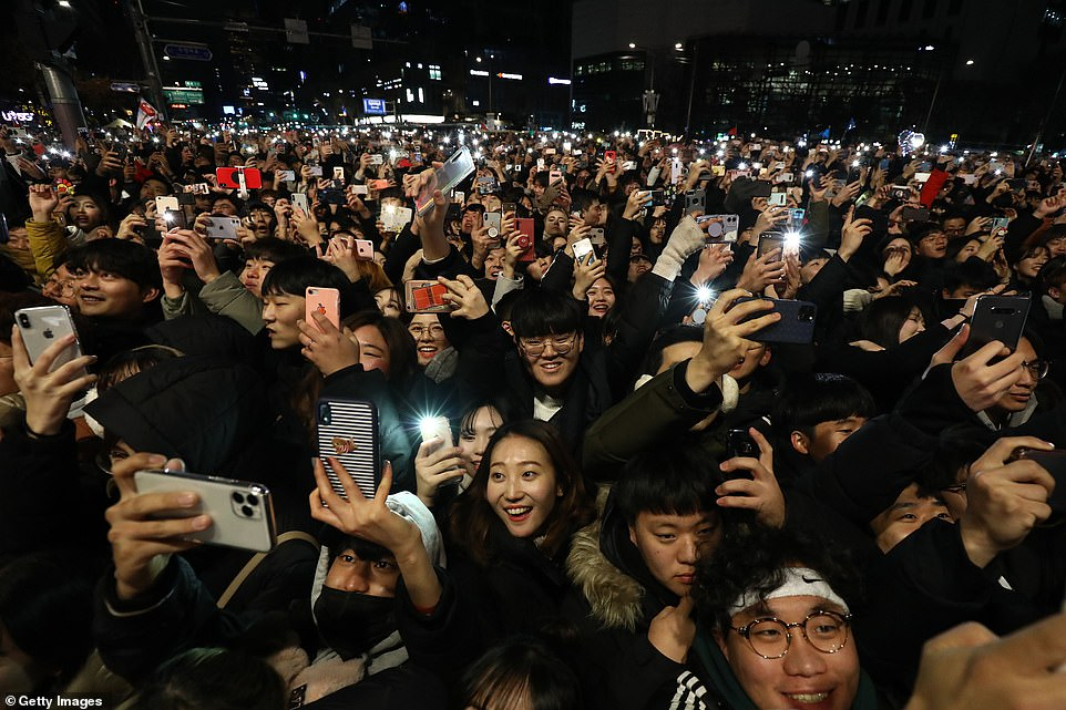 People gather to celebrate New Years at the Bosingak pavilion on January 1, 2020 in Seoul, South Korea