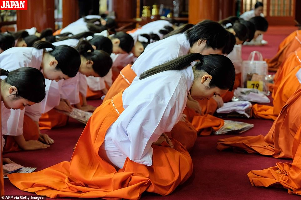 Japanese priestesses offer up New Year prayers at Kanda Myojin Shrine in Tokyo