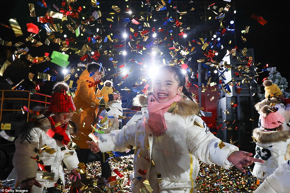 A young child celebrates the arrival of the year 2020 at a New Year's Eve countdown event at Shougang Park on December 31, 2019 in Beijing, China
