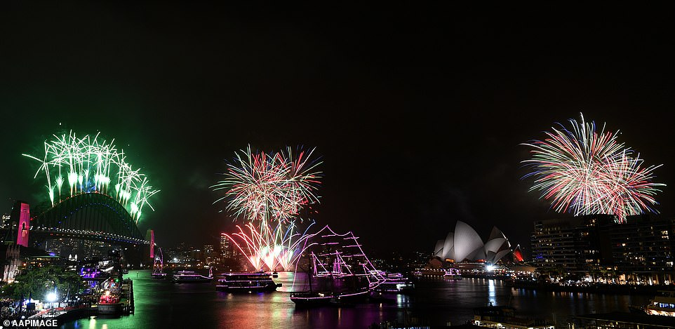 Fireworks explode to welcome in the New Year over the Sydney Harbour Bridge and the Sydney Opera House
