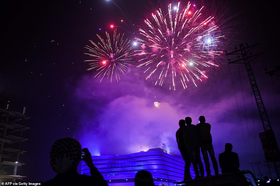 People watch fireworks as part of the New Year celebrations in Rawalpindi on January 1, 2020