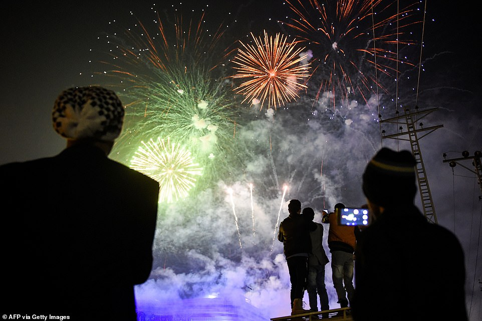 People watch fireworks as part of the New Year celebrations in Rawalpindi, Pakistan