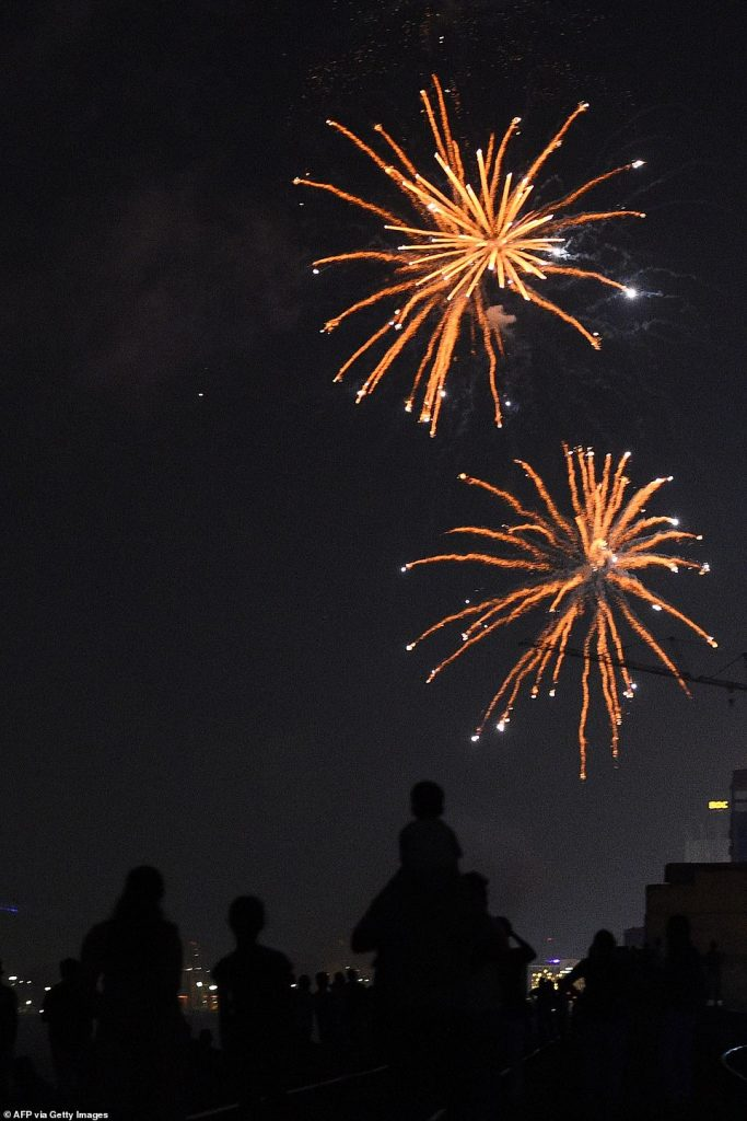 Sri Lankans watch fireworks during new year's celebrations in Colombo, on January 1, 2020