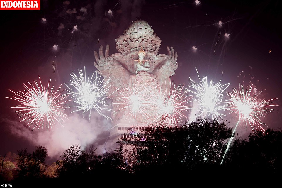 Fireworks explode after midnight over Garuda Wisnu Kencana cultural park as part of New Year celebrations in Bali, Indonesia