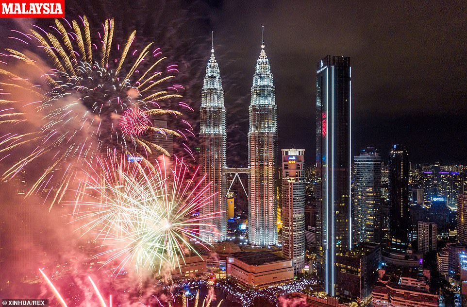 New Year fireworks explode near the Petronas Twin Towers New Year Celebrations, Kuala Lumpur, Malaysia on 01 Jan, 2020