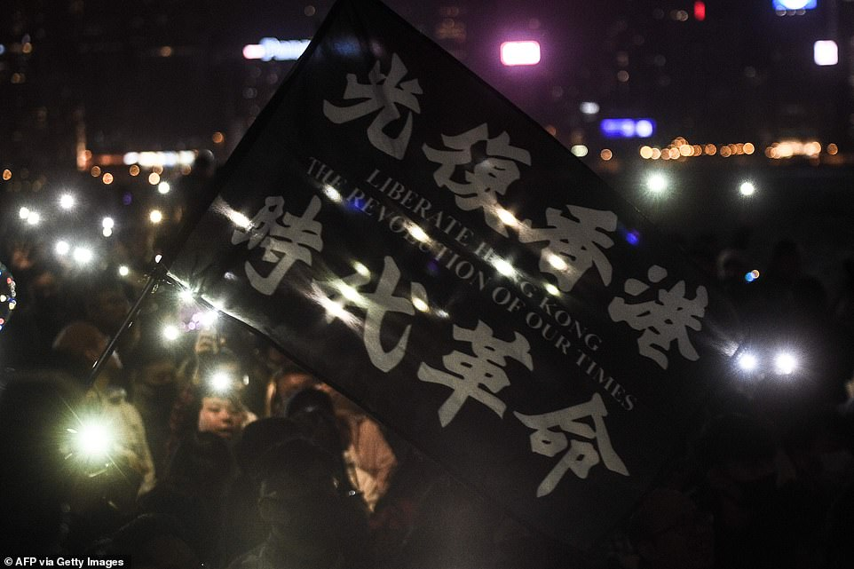 Pro-democracy protesters and people gather at the promenade of Tsim Sha Tsui district, Hong Kong, as they they take part in a rally and to celebrate New Year