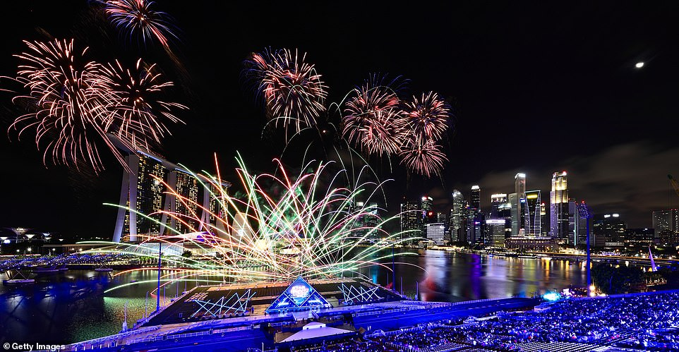 Singapore awaits 2020 with curtain-raiser fireworks by Star Island as revellers join in the biggest celebration at Marina Bay