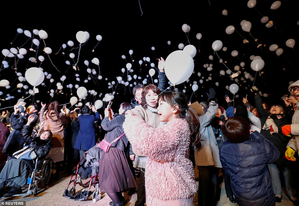 Revellers release balloons as they take part in New Year countdown event in Tokyo, Japan