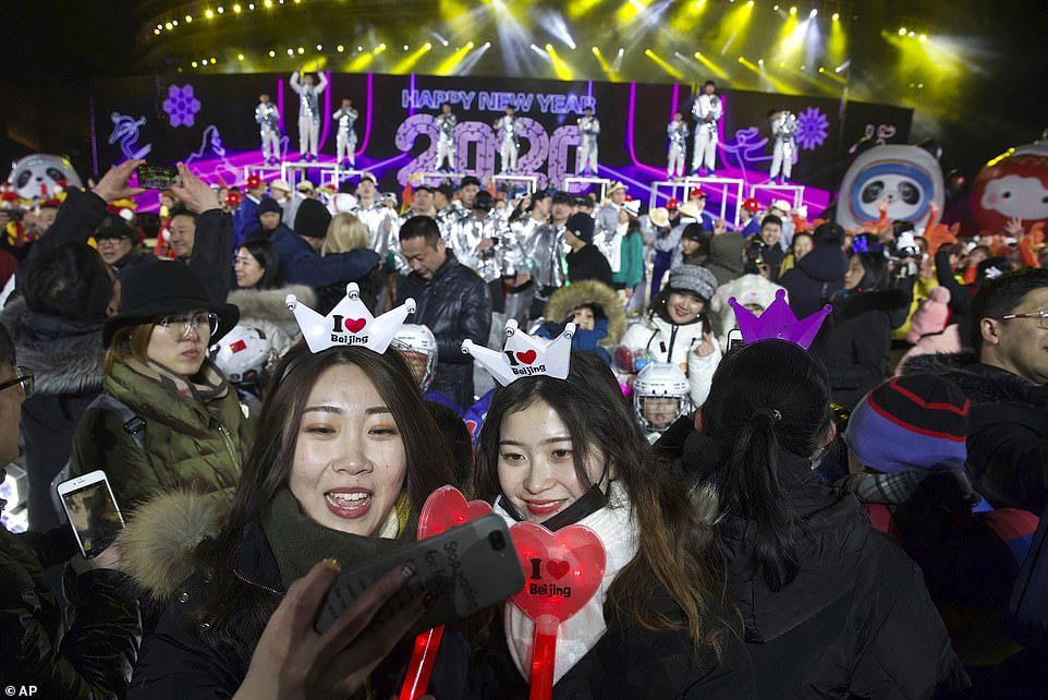 People celebrate the arrival of the year 2020 at a New Year's Eve countdown event near the 2022 Beijing Winter Olympic headquarters in Beijing January 1, 2020