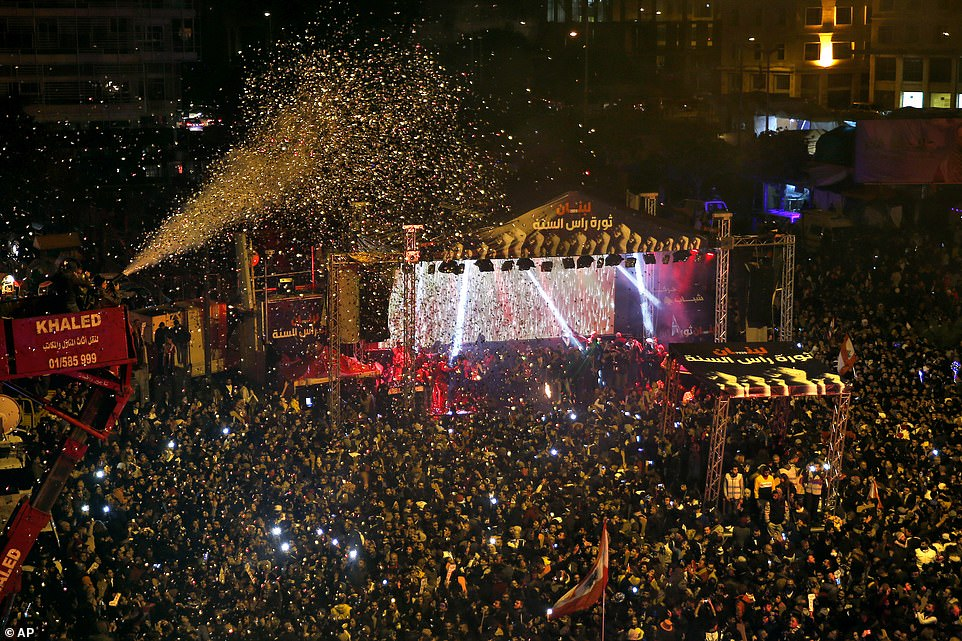 Thousands of anti-government protesters and citizens gather during the New Year's celebrations in Martyrs' Square in downtown Beirut, Lebanon, Wednesday, January 1, 2020. Protesters have been holding demonstrations since October 17 demanding an end to widespread corruption and mismanagement by the political class that has ruled the country for three decades