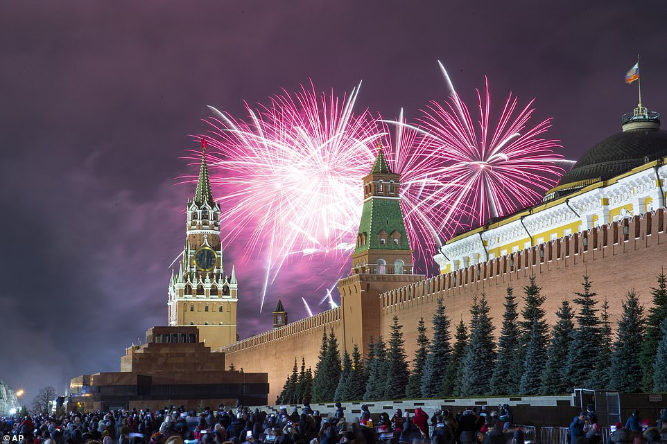 Fireworks explode over the Kremlin tonight during New Year's celebrations in Red Square in Moscow, Russia