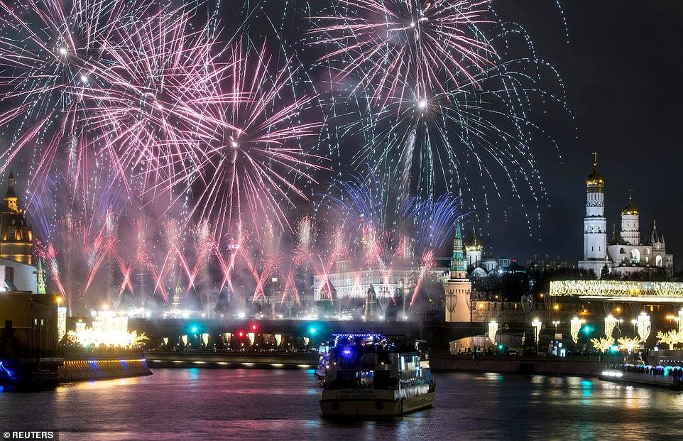 The view from the Moskva River of the New Year's Eve celebrations over Red Square in Moscow this evening