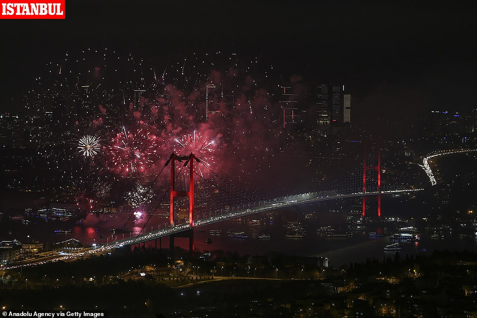 Fireworks illuminate the night sky behind July 15 Martyrs' Bridge within the new year celebrations in Istanbul, Turkey on January 01, 2020