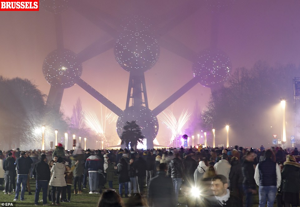 Fireworks light up in the fog in front of Atomium Monument to celebrate the arrival of the new year 2020, in Brussels, Belgium, 01 January 2020