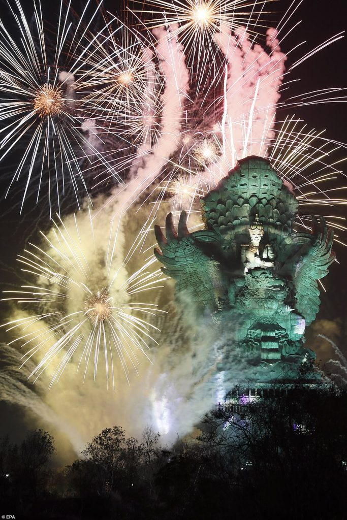 Fireworks explode after midnight over Garuda Wisnu Kencana cultural park part of New Year celebrations in Bali, Indonesia