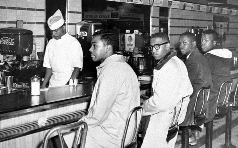 A group of 20 A&T College students occupied lunch counter seats at the downtown F.W. Woolworth Co. store. They are, from left, Joseph McNeil, Franklin McCain, Billy Smith and Clarence Henderson.